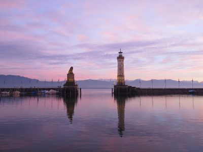 Lindau Germany_Lighthouse and Lion Statue on Lake Constance at sunset_Landscape_KellyCosgrove
